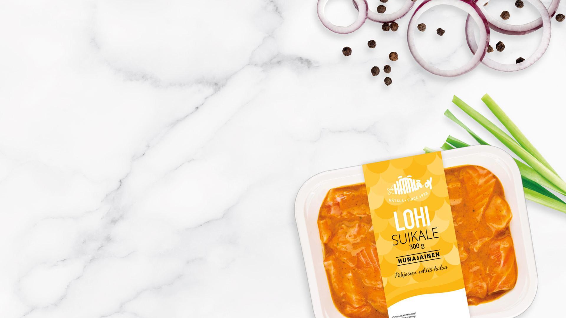 Lohisuikale Hunajainen 300 g pakkaus marmoripinnallalla | Kalatuotteet | Hätälä
