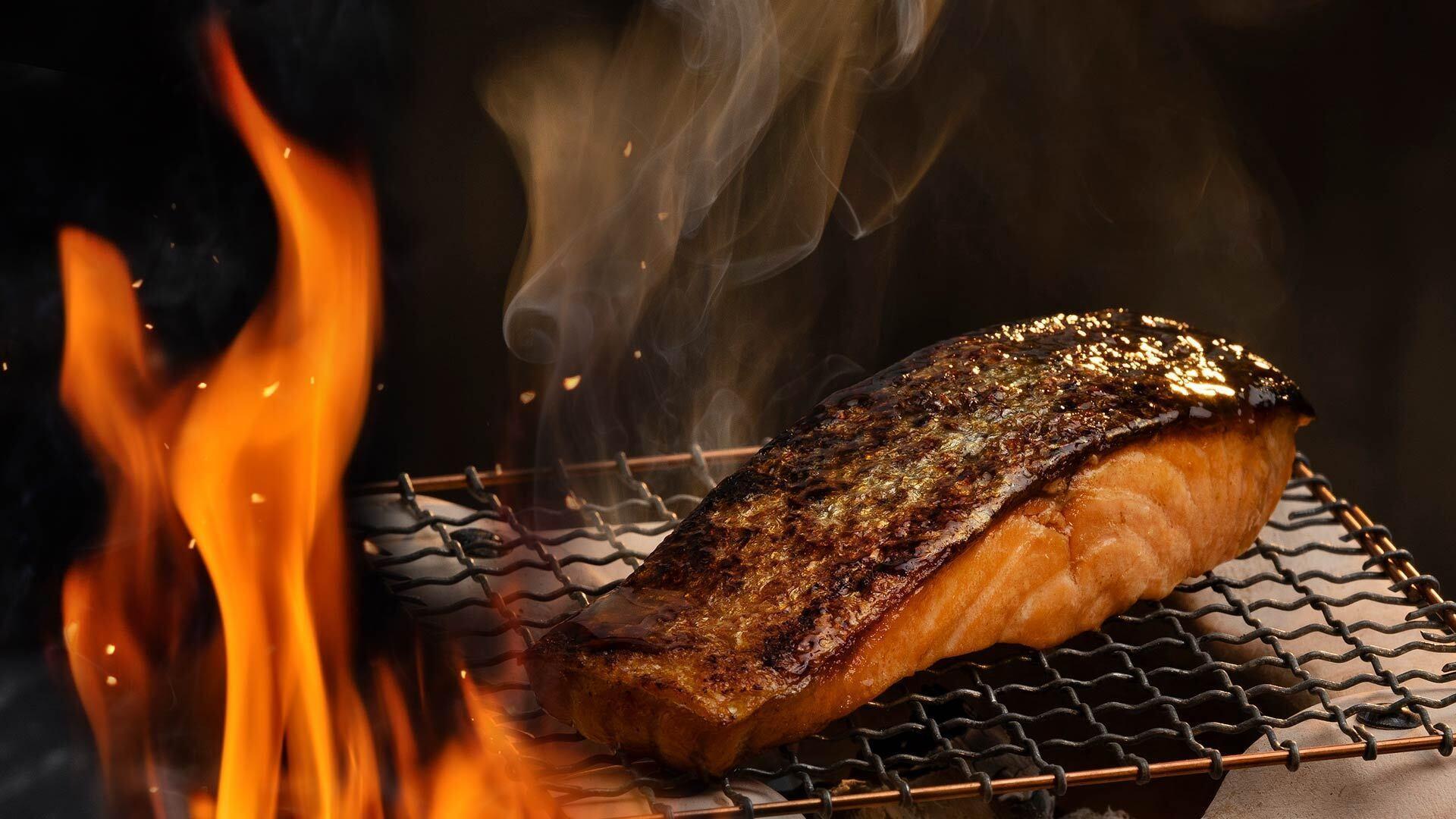 Kesä ja grillaus sivun herokuva, lohifileepala grillissä